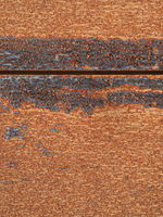 Rusty metal plates with a dark gap