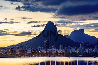 Rodrigo de Freitas lagoon lights and hills at dusk