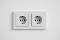 white double socket on wall - electric plug