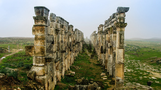 Great Colonnade at Apamea in fog, partially destroyed , Syria