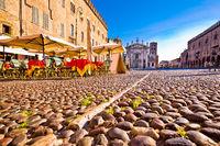 Mantova city paved Piazza Sordello and idyllic cafe view