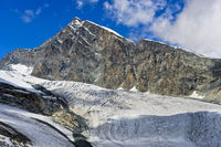 Peak Allalinhorn rises above the glacier Allalingletscher, Saas-Fee, Valais, Switzerland