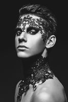 handsome young man with lace on face