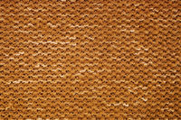 Texture of yellow knitted fabric macro
