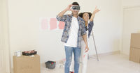 Man using virtual reality glasses gets help