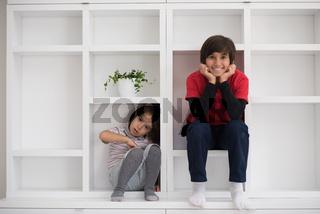 young boys posing on a shelf