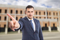 Real estate sales man showing no gesture outdoors