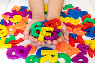 Child learning using magnetic letters and numbers