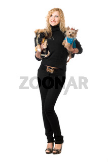 Cheerful young blonde posing with two dogs. Isolated