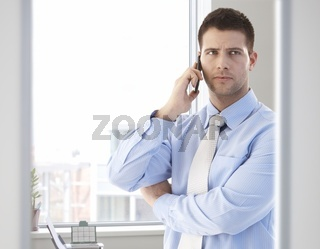 Casual office worker talking on mobile phone