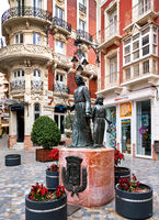 Cartagena, Spain - January 29, 2017: View to the Gran Hotel and bronze statues on the square of San Sebastian in Cartagena city. Spain