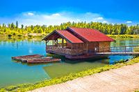 Drava river floating wooden cabin
