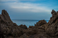 Blue sea and sky view between rocks