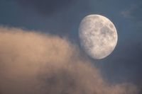 Waxing gibbous with clouds in the evening
