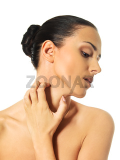 Topless woman scratching her neck