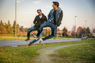 Two Men Leaping in Unison with Hands in Pockets