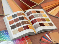 Interior design and house renovations concept. Catalog of wood samples, color palette and leather swatches.