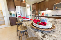 Abstract of Beautiful Kitchen Granite Counter Place Settings and Chairs.
