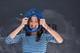 woman holding a internet cable in front of chalk drawing board