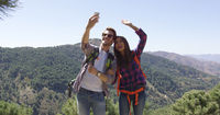Young smiling couple taking picture of themselves