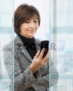 Senior businesswoman using mobile