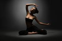 Studio photo of beautiful sexy girl doing yoga
