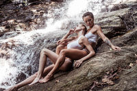 Sensual beauties by the waterfall