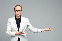 Business woman showing hand sign to side.