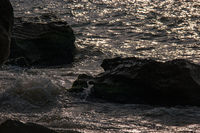 Rocks in the sea in front of sunset on the Tropical sea beach