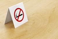 No smoking sign on table