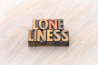 loneliness word abstract in wood type
