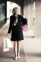 Young fashion woman with shopping bags walking in the mall
