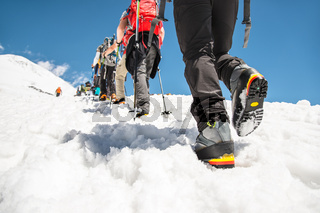Close-up of the legs of a group going uphill