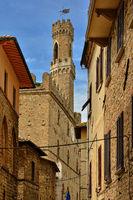 alley in Volterra with view on the Palazzo dei Priori