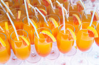 orange juice mixed in a flute