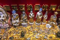 chinese religious trinkets and statues on display in xiamen china