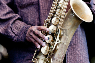 Hand and Saxophone of a musician