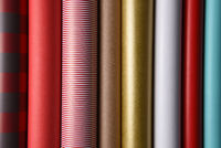 Closeup of a variety of wrapping paper rolls.