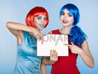 Females with paper in hands. Portrait of young women in comic pop art make-up style