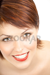 Portrait of the smiling woman on a white background