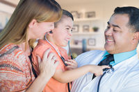 Young Boy and Mother Visiting with Hispanic Doctor in Office