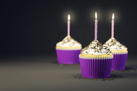 delicious cupcakes with a burning candles