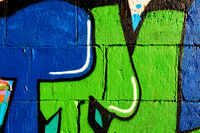 Graffiti on wall. Green, black and blue colors