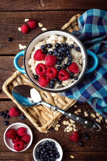 Oatmeal porridge with fresh berries, oats with blueberry and raspberry