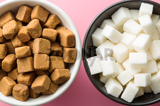 Brown and white sugar cubes.