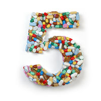 Number 5 fiive. Set of alphabet of medicine pills, capsules, tablets and blisters isolated on white.
