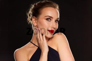 beautiful woman in black over dark background