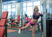 Photo of attractive blonde exercising in gym