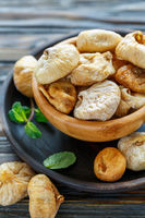 Sweet dried figs in a wooden bowl.