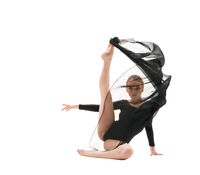 Young pretty gymnast with black cloth studio shot